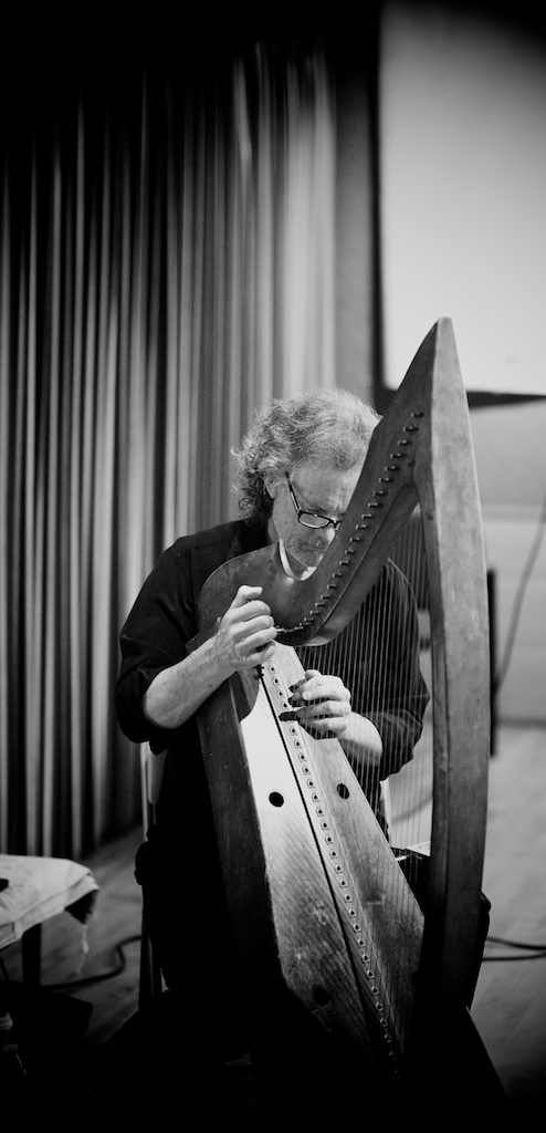 Patrick Ball tuning his harp during the first event of the 2014 Ojai Storytelling Festival.